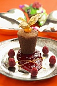 Small chocolate soufflé with raspberry sauce
