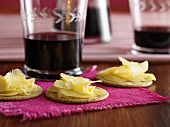 Cheese on crackers and glasses of red wine