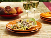 Chicken and peach salad with peanuts