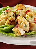 Fried scallops on a bed of lettuce