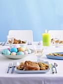 Pork chop and Easter eggs on Easter table