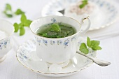 Peppermint tea with white sugar crystals