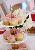 Cupcakes with pink icing on tiered stand
