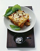 Baked mince and potato dish with almonds