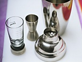 Bar utensils (cocktail shaker and measure)