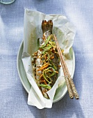 Asian-style trout in greaseproof paper