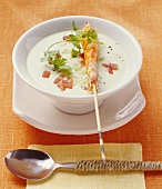 Cold avocado and coconut soup with skewered prawn