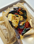 Cod and mussels with saffron in parchment paper