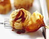 Choux pastry with orange and caramel filling