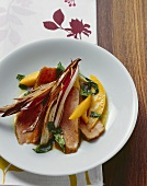 Fried veal loin steak with mango, radicchio di Treviso & basil