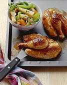 Poussin with root vegetables cooked in roasting bag