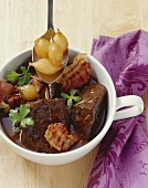 Beef casserole with pearl onions, marjoram and lemon