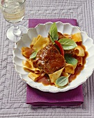 Braised veal cheeks in tomato gravy with chilli and basil