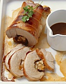 Rolled roast suckling pig with prunes and apricots