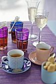 Espresso, tea with sugar swizzle sticks & sparkling wine