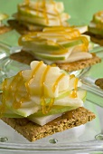Graham crackers topped with apple & cheese slices & caramel