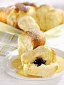 Buchteln (sweet yeast dumplings) with plum jam and custard