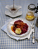 Leg of goose with potato dumpling and red cabbage
