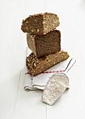 Three types of bread, flour in scoop