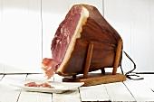 Smoked ham (Heideschinken) on ham stand