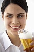 Young woman drinking a glass of beer
