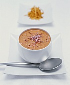 Cream of carrot soup with red onions