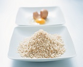 Breadcrumbs and a broken egg (for coating)