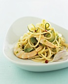 Spaghetti with courgette slices, prawns and garlic