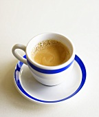 Espresso in blue and white cup and saucer