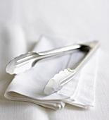 Cake tongs on fabric napkin