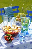 Sangria and water on summery table out of doors