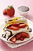 Pancakes with strawberries and chocolate & orange sauce