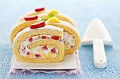 Sponge roll filled with mascarpone cream, mango & strawberries