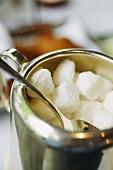 Sugar cubes in a silver sugar bowl