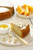 Almond cake with orange and cinnamon sauce