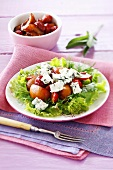 Lettuce with balsamic fruit and blue cheese