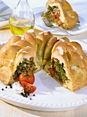 Gugelhupf with tomato and spinach filling