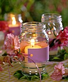 Candle in screw-top jar with snapdragons