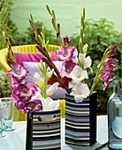 Gladioli in striped paper bags (table decoration)