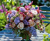 Arrangement of roses, aquilegias and bleeding heart