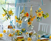 Easter breakfast table decorated with narcissi