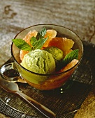 Lime and mint ice cream with grapefruit and mint leaves