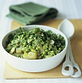 Pea and potato salad with spring onions
