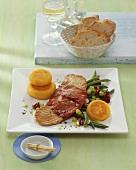 Pork escalope with ham, vegetables and potato cakes