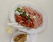 Cold cut platter with Easter ham and boiled quails' eggs