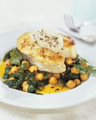 Baked halibut steak on chick-peas