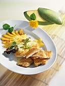 Coconut-coated chicken escalopes with mango salad