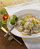 Potato salad with mayonnaise and nasturtium leaves