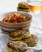Couscous and courgette cakes with tomato salad