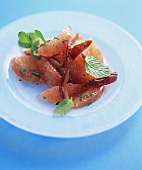 Pink grapefruit segments with dates and mint